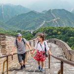 Couple climbing staircase - Tour China