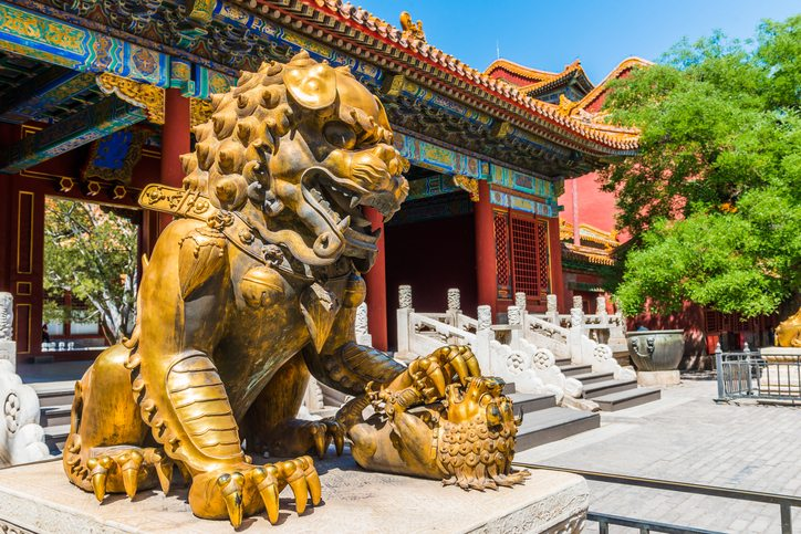 Bronze lion in front of the Hall of Supreme Harmony in Beijing Forbidden City - visit China